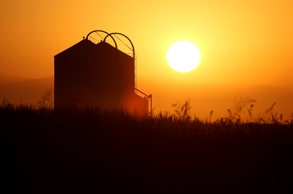 The sun rises over a farm on August 22, 2014 near Firebaugh, California. An Associated Press investigation shows uranium increasingly is showing in drinking water systems in major farming regions of the U.S. West, including California's Central Valley.
