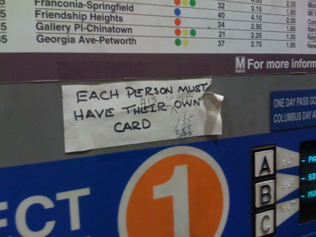 Grammar corrections on a Metro farecard machine in Ballston Metro station, Arlington, Va.