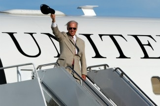 US Vice President Joe Biden waves while boarding Air Force 2 at US Yokota air base as he completes his tour of Japan, China and Mongolia on August 24, 2011.