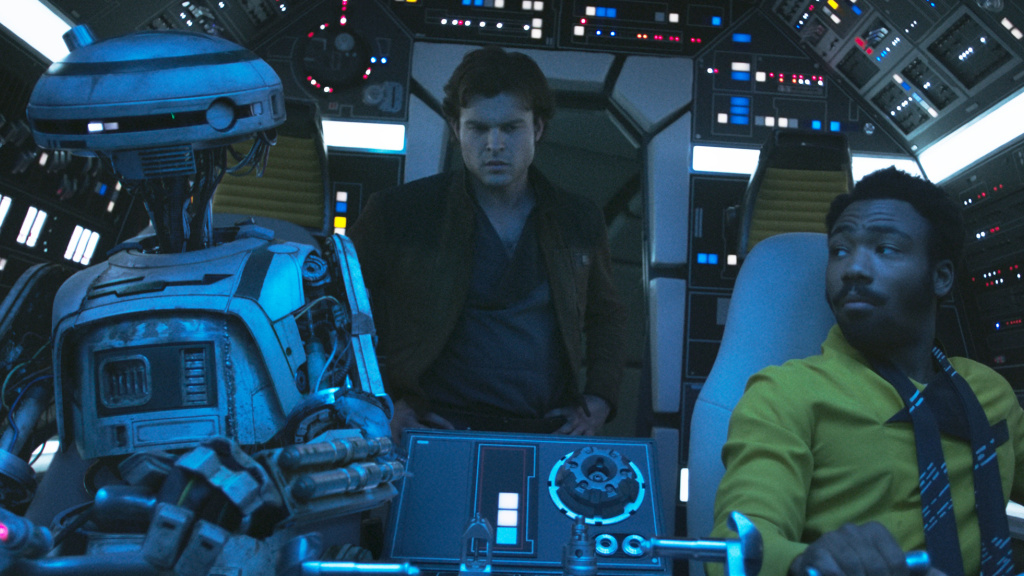 Never tell him the odds: L3-37 (Phoebe Waller-Bridge), Han Solo (Alden Ehrenreich) and Lando Calrissian (Donald Glover) in <em>Solo: A Star Wars Story</em>.