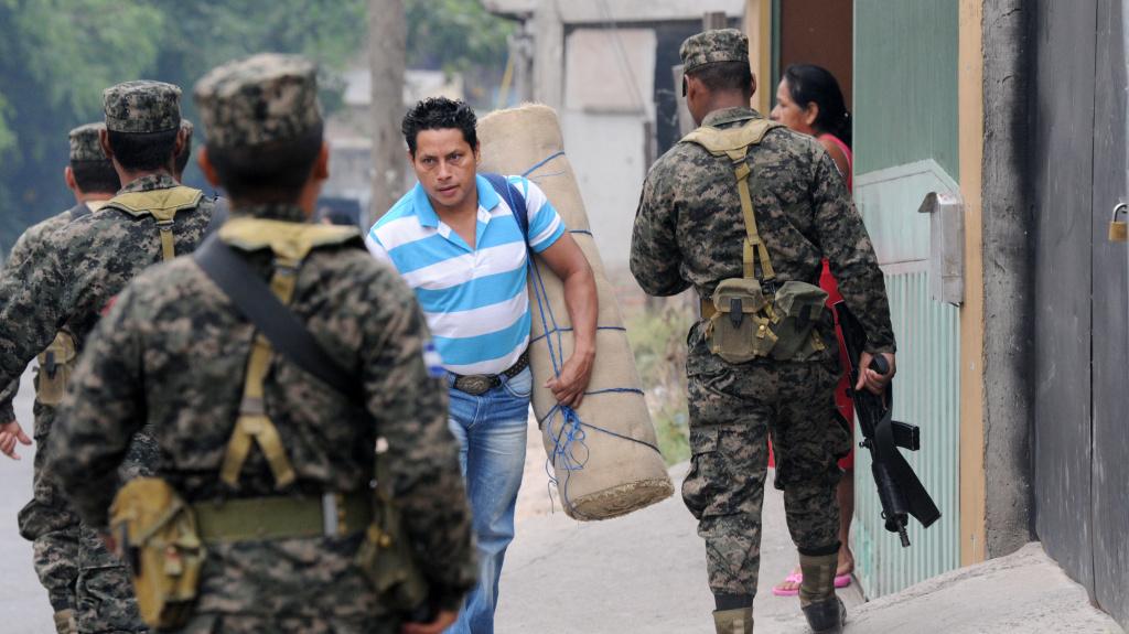 Honduran Army soldiers patrol streets in Tegucigalpa, Honduras, in April. Gang violence has many Hondurans fleeing to the U.S.