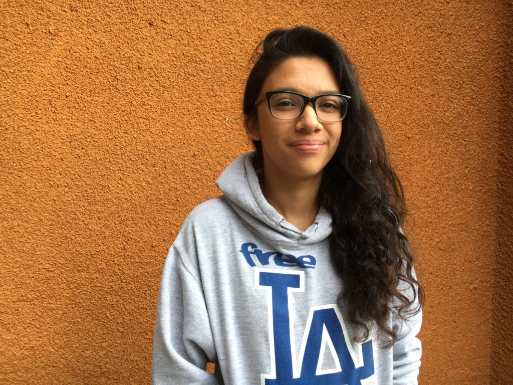 Nancy Flores, 19, is a student and works with younger teens in an after-school program in Boyle Heights. She said she is