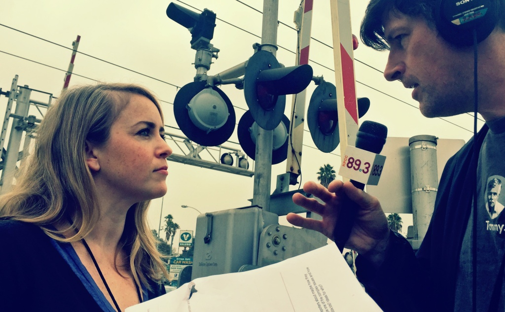 KPCC transportation reporter Meghan McCarty and Off-Ramp host John Rabe meet at a Gold Line crossing in Pasadena to talk about how Meghan approaches covering ballot measure M.