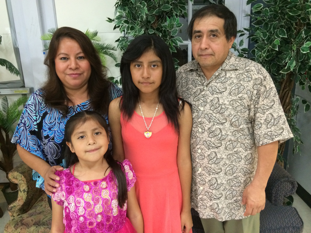 The Sandoval-Rojas family is expecting 2015 to be a better year for them. Mother, Isobel Sandoval, left, qualifies for the deportation relief program and plans to apply in the spring. Sandoval along with her two daughters, Guadelupe and Marisol, and husband, Eraclio, will then be able to travel more freely.