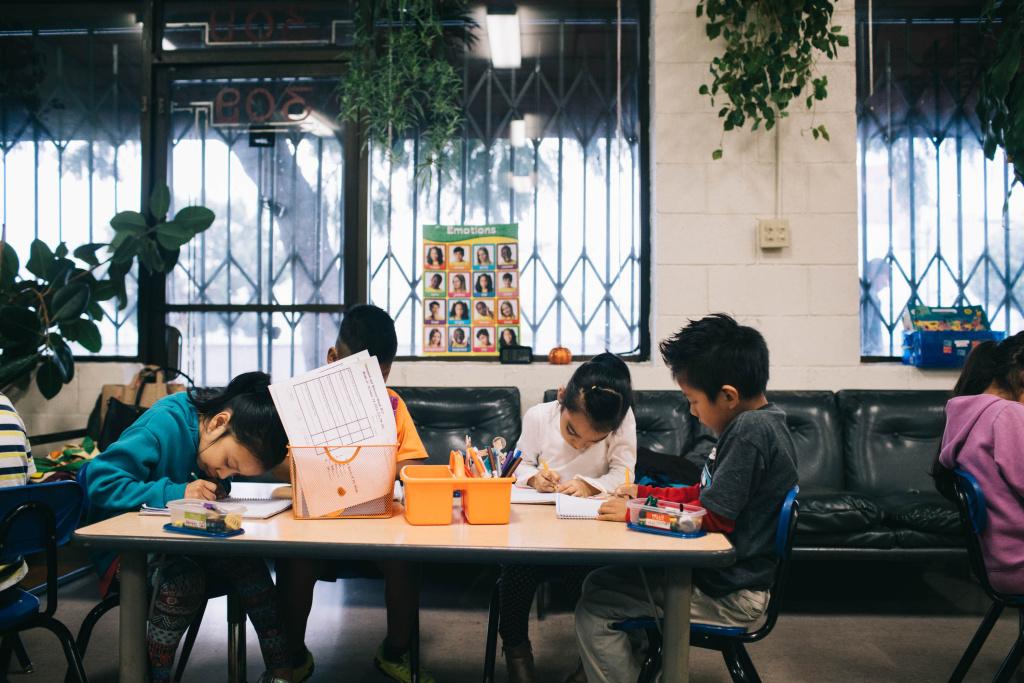 Students at Las Familias Del Pueblo, an after-school program in Los Angeles, practice sentence structure and language.