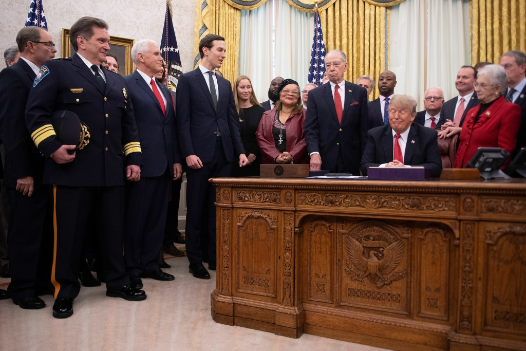 President Trump at the signing ceremony for the First Step Act last December. The criminal justice overhaul has led to the early release of some 500 federal prisoners but has also encountered missed deadlines and a lack of funding.