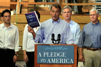 House Minority Leader John Boehner (R-OH), holds a copy of 'A Pledge To America', House Republicans' proposed governing agenda for the upcoming 111th Congress.