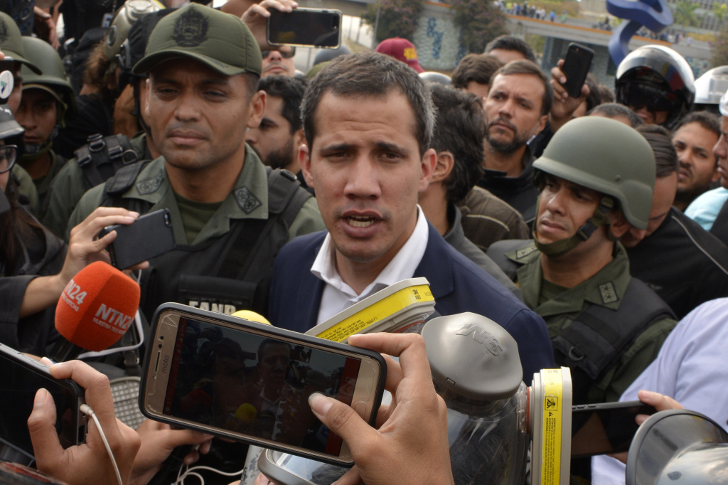 Venezuelan opposition leader Juan Guaidó, recognized by many members of the international community as the country's rightful interim ruler, talks to media outside the airforce base La Carlota on April 30, 2019 in Caracas, Venezuela.