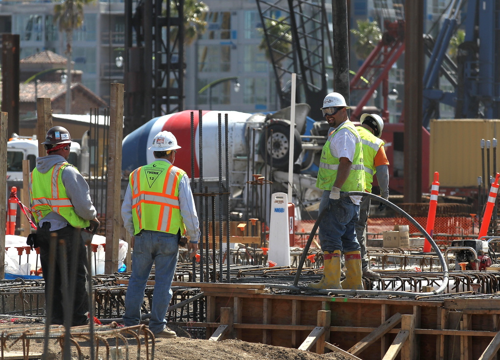 Workers pour concrete at the construction site for the Channel Mission Bay housing development on March 23, 2012 in San Francisco, California.
