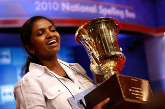 Fourteen-year-old Anamika Veeramani of Cleveland, Ohio, hoists her trophy after winning the Scripps National Spelling Bee June 4, 2010 in Washington, DC.
