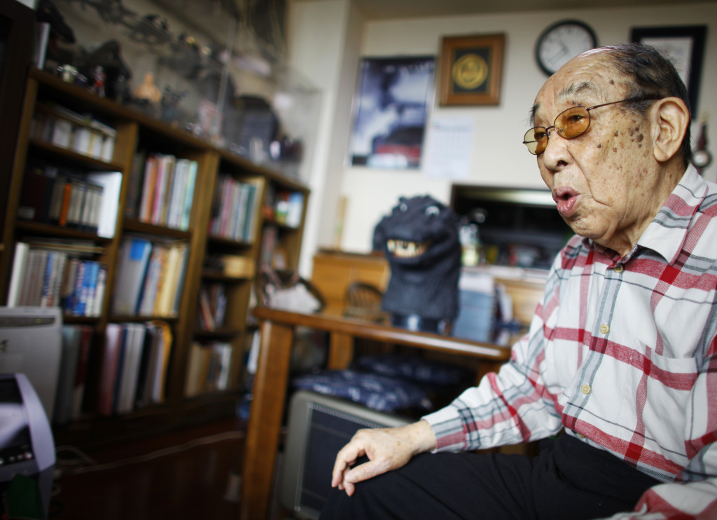 "File: In this Monday, April 28, 2014 photo, original Godzilla suit actor Haruo Nakajima, who has played his role as the monster, speaks during an interview at his home in Sagamihara, near Tokyo. ""I am the original, the real thing,"" Nakajima, 85, said, stressing that later Godzilla are mere imitations. ""If Godzilla can't walk properly, it's nothing but a freak show."" The theme of his Godzilla was grander and more complex, addressing universal human dilemma, as it spoke to a Japan that still remembered wartime suffering, he said."