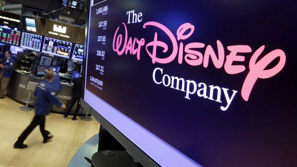 The Walt Disney Co. logo appears on a screen above the floor of the New York Stock Exchange.