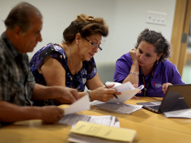 Affordable Care Act navigator Nini Hadwen helps folks shop for health insurance in October.