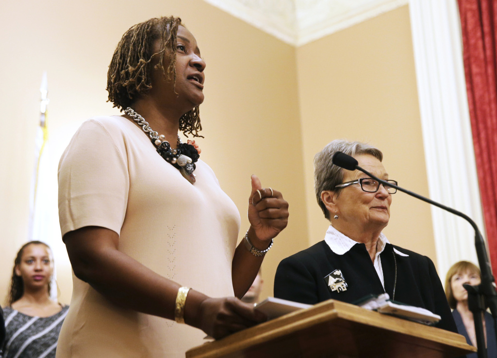 State Sen. Holly Mitchell, D-Los Angeles, left, speaks at a news conference at the Capitol in Sacramento, Calif., in this June 10, 2015 file photo. Mitchell and Sen. Ricardo Lara of Bell Gardens (not pictured) are proposing four bills intended to keep more youthful offenders out of the criminal justice system.