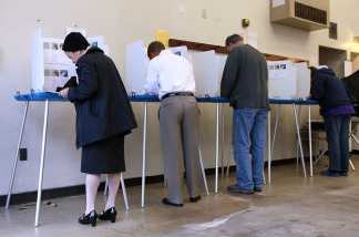 Voters fill out ballots at a polling place in a fire station on June 8, 2010 in Riverside, California.