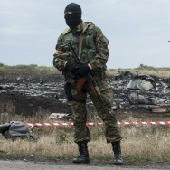 A pro-Russian fighter guards the crash site of Malaysia Airlines Flight 17 near the village of Hrabove, eastern Ukraine on July 19, 2014. Ukraine said the passenger plane was shot down as it flew over the country, killing all 298 people on board.