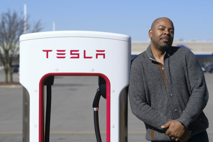 Roger Croney, a former Telsa employee, poses for a portrait at a Tesla charging station in Ft. Wayne, Ind. Thursday, March 22, 2018. (Photo by AJ Mast for The Center for Investigative Reporting)