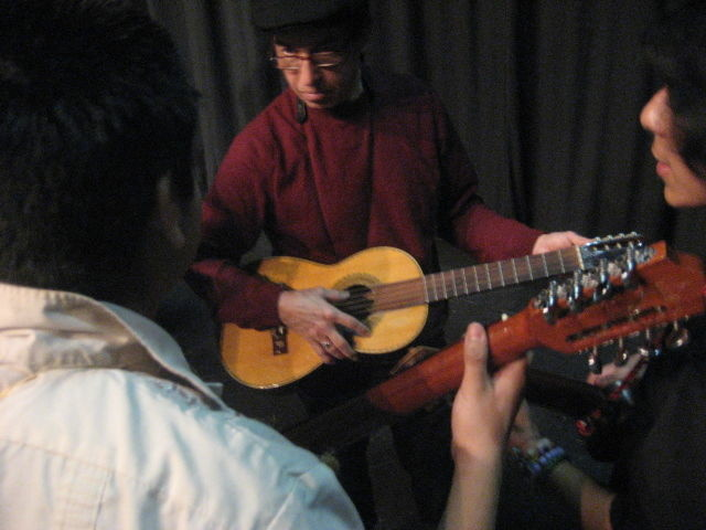Los Lobos guitarist Louie Perez tunes up with students learning jarana at Frida Kahlo High School.