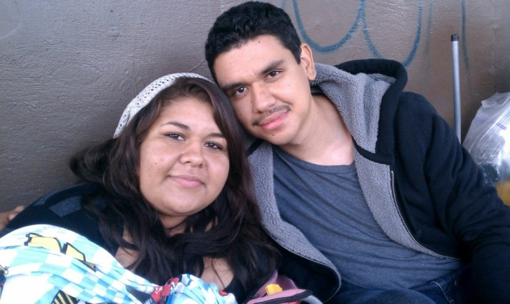 Evelin Nunez, 16, of Downey and her cousin Felipe Paz, 21, of Pico Rivera camped overnight in downtown Los Angeles. Both are seeking