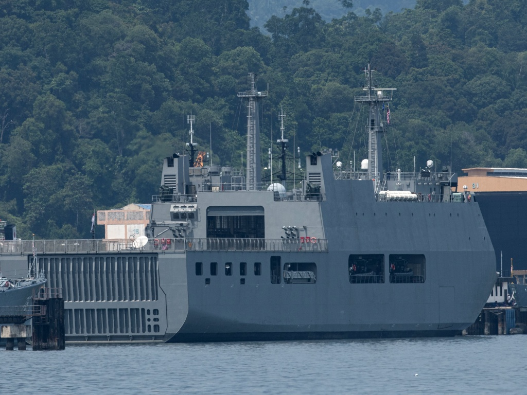 Myanmar vessel UMS Moattama, which was sent to return Myanmar migrants from Malaysia, is seen docked at a jetty outside Kuala Lumpur on Monday.