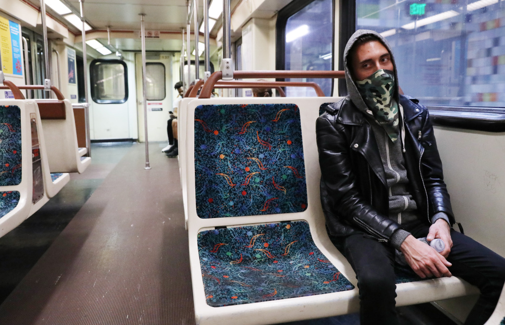 Transit rider Arthur Glover wears a bandana while riding a Los Angeles Metro Rail train amid the coronavirus pandemic on April 1, 2020 in Los Angeles, California.