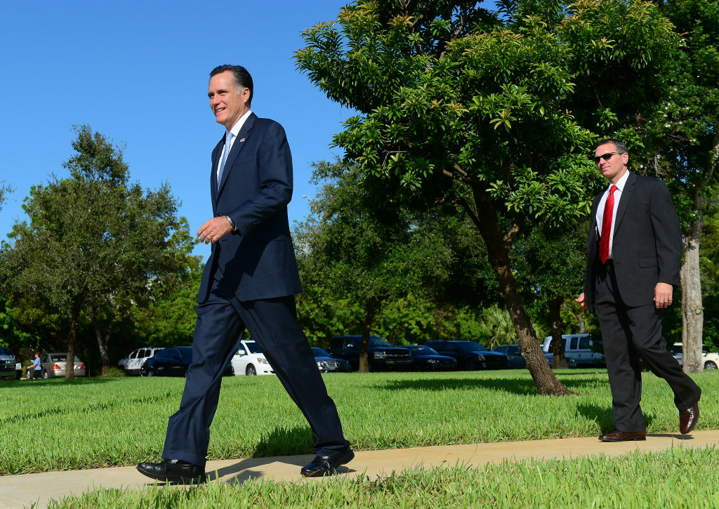 US Republican presidential candidate Mitt Romney leaves the Church of Jesus Christ Latter Day Saints in Boca Raton, Florida, October 21, 2012.