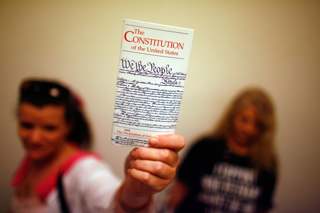 Elementary school teacher Lisa Petry of Virginia Beach, Virginia, holds up a copy of the U.S. Constitution.