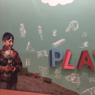 """Play"" exhibit welcome wall"