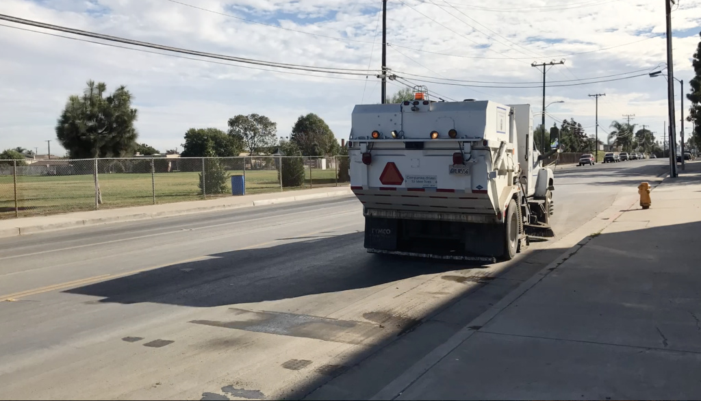 A garbage truck drives along Nichols Lane, which separates Oak Park Elementary School from the waste transfer station operated by Republic Services.