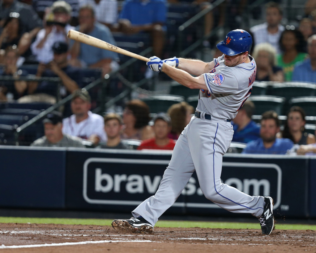 Second baseman Daniel Murphy #28 of the New York Mets follows through on a swing for a sixth inning RBI single during the game against the Atlanta Braves at Turner Field on September 3, 2013 in Atlanta, Georgia.