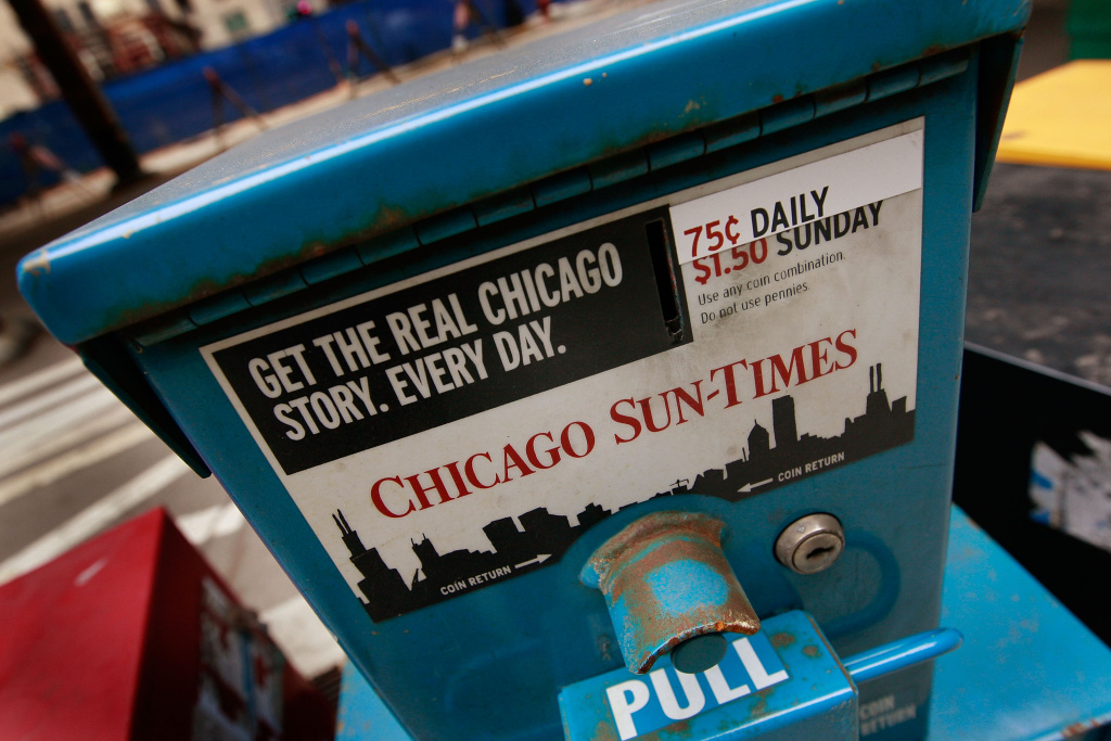 Chicago Sun-Times newspapers are offered for sale April 2, 2009 in Chicago, Illinois. The newspaper laid off its staff photographers and will rely on freelancers and wire services.