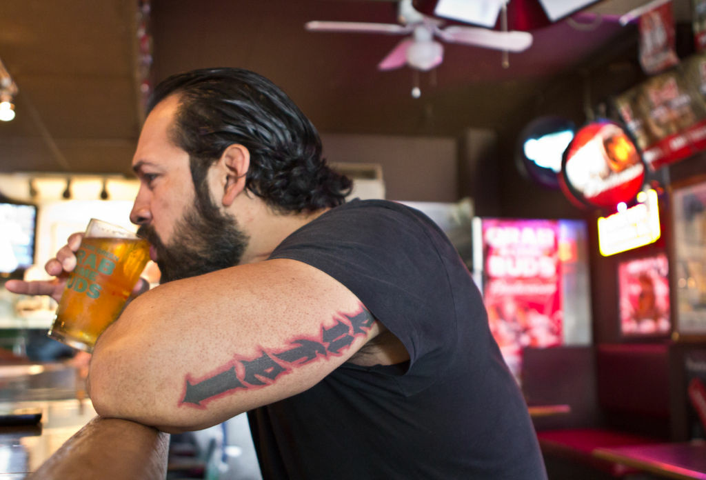 Rick Martinez drinks a sip from his beer at the King Eddy Saloon in Downtown Los Angeles.