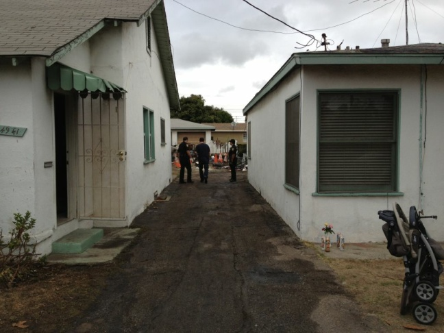The charred bungalow where officials found the body of a gunman accused of attacking an Inglewood family living in the front house, early Saturday. Officials described the man as a