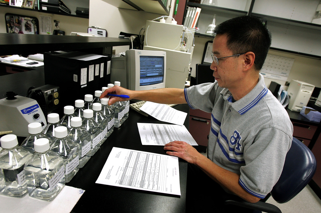 Quality control technician Frank Pantaleon works at his lab station on part of the development of the synthetic blood substitute PolyHeme at Northfield Labs in Mount Prospect, Illinois.