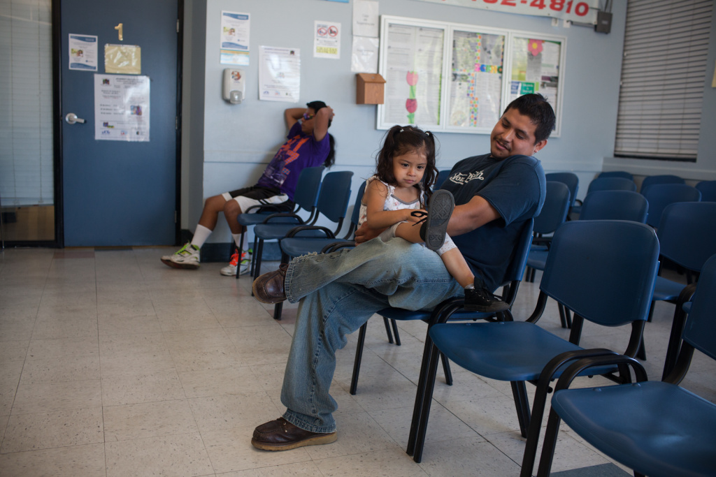 Alondra Manzanarez and her father David wait for care at the South Central Family Health Center. They do not have insurance and have been coming to the center for three years.