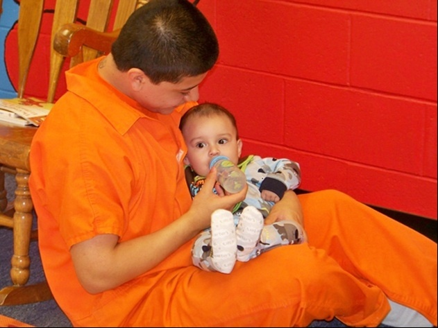 "An outreach program dubbed the ""Baby Elmo Program"" attempts to break the cycle of violence by teaching parenting skills to incarcerated teenage fathers."