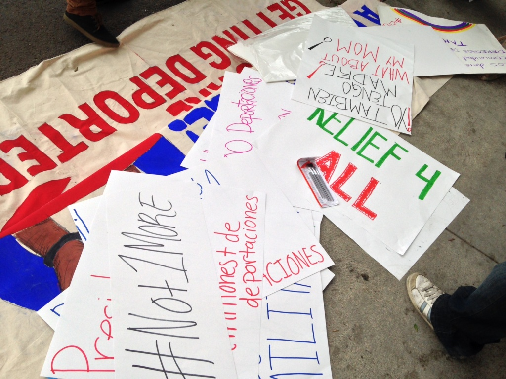 Pro-immigration protesters' signs lay on the ground in Los Angeles during a rally on Thursday, Nov. 20, 2014.