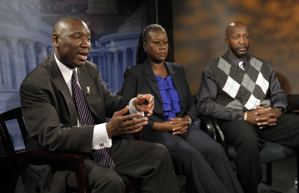Ben Crump, left, then attorney for Trayvon Martin's parents, left, and The Martin's parents, mother  Sybrina Fulton, center, and father Tracy Martin are interviewed by The Associated Press in Washington, Wednesday, April 11, 2012. Crump now represents the family of Stephon Clark.