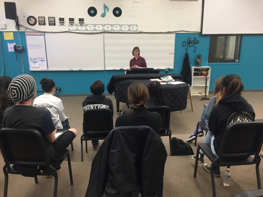 Canyon High director of vocal music Ariel May speaks to her Advanced Treble Clef class.