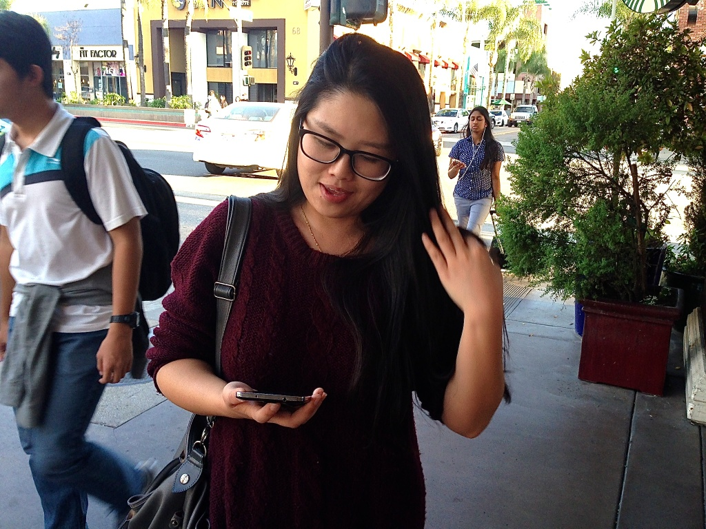 Lauren Zhang, who was visiting a friend in Alhambra, scrolls through her WeChat account.
