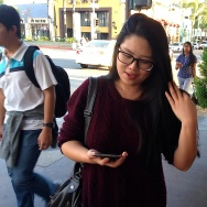 "Lauren Zhang, who was visiting a friend in Alhambra, scrolls through her WeChat account. ""All Chinese use it,"" Zhang said."