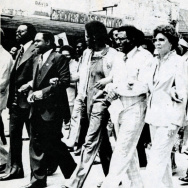 "An undated photo from the exhibit shows Southern Christian Leadership Conference officials leading demonstrators in a march ""against fear and injustice"" in Decatur, Ga."