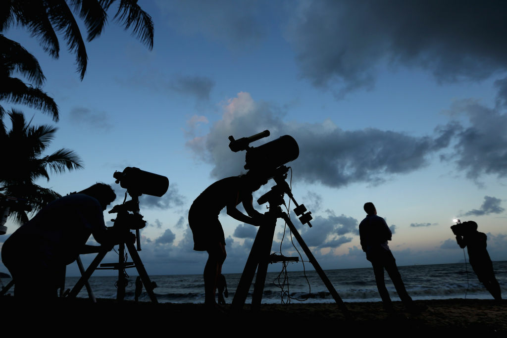 Telescopic cameras and computer equipment are set up on Palm Cove beach in preparation to run a live stream via NASA of the total solar eclipse on November 13, 2012 in Cairns, Australia. Thousands of eclipse-watchers have gathered in part of North Queensland to enjoy the solar eclipse, the first in Australia in a decade.