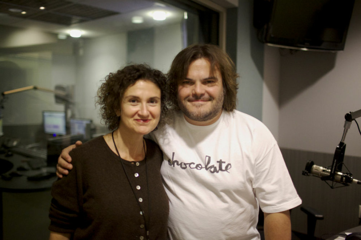 Jack Black poses with Take Two host Alex Cohen in studio.