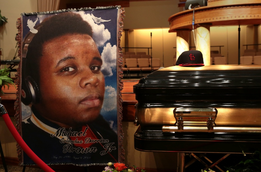File: The casket of Michael Brown sits inside Friendly Temple Missionary Baptist Church awaiting the start of his funeral on Monday, Aug. 25, 2014.