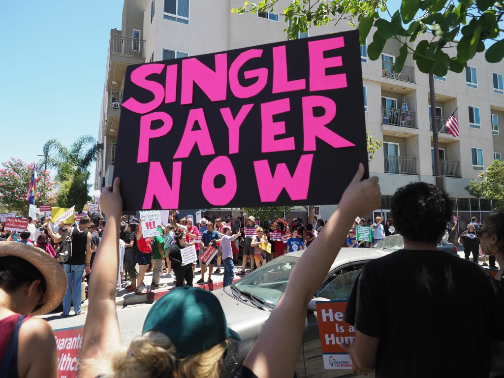 Backers of a single-payer system rally outside the South Gate office of Assembly Speaker Anthony Rendon in June 2017, after he shelved the single-payer bill, SB 562.