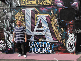 Alfred Lomas used to be in the Florencia 13 gang before he founded LA Gang Tours. Now, in addition to running the tours, Lomas also manages a mobile food bank.