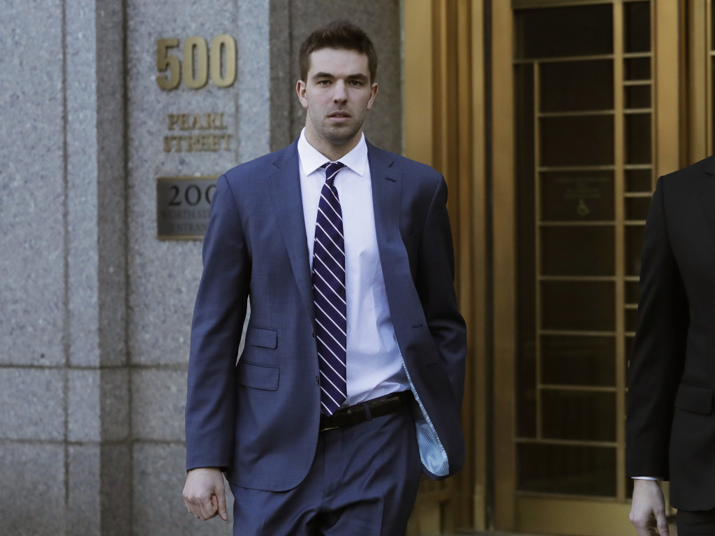 Billy McFarland, pictured leaving federal court in March 2018, was sentenced to six years in prison after pleading guilty to fraud charges related to the failed Fyre Festival. Ticket holders and event organizers reached a settlement in a class-action suit this week.