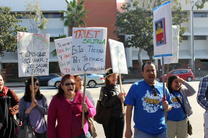 Nonprofit Trust South L.A. organized a rally outside a vacant lot on Vermont Street on Wednesday across from the University of Southern California. They want state lawmakers to help them recover funding for low-income housing projects.