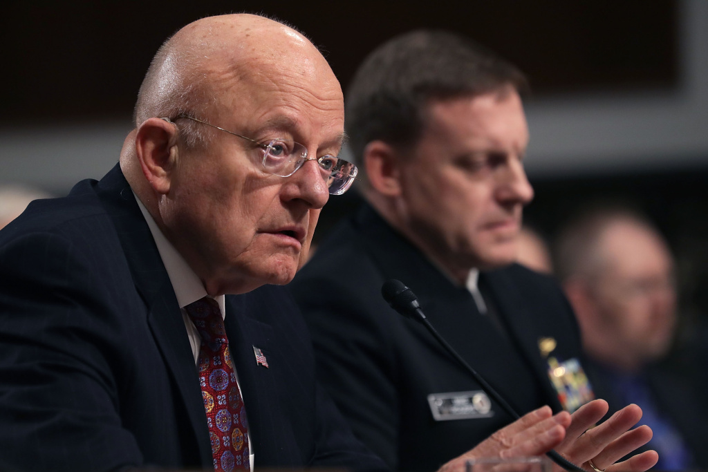 Director of National Intelligence James Clapper (L) and United States Cyber Command and National Security Agency Director Admiral Michael Rogers testify before the Senate Armed Services Committee in the Dirksen Senate Office Building on Capitol Hill January 5, 2017 in Washington, DC.